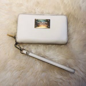 Cream Michael Kors zipper wallet wristlet